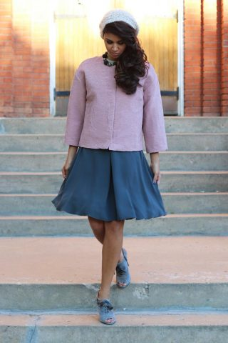Textured boxy jacket over  silk dress with knit hat